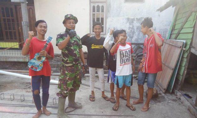 Satgas TMMD di Desa Kali Kondang Demak Arahkan Kelompok Anak Jalanan Untuk Berkarya