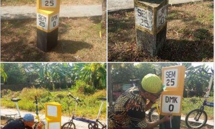 Pengecatan Ulang Patok Titik Nol Kilometer Demak Oleh Pesepeda Demak