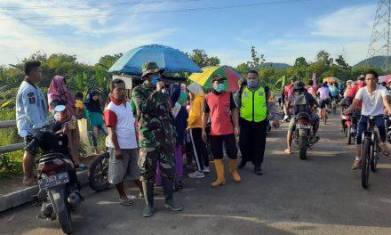 Dengan Berjalan Kaki, Tiga Pilar Desa Banyumeneng Berikan Himbaun Kepada Masyarakat Terkait Penyebaran Virus Corona